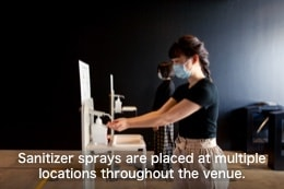 Sanitizer sprays are placed at multiple locations throughout the venue.